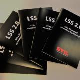 STILs rapport LSS 2.0, vit text på svart bakgrund